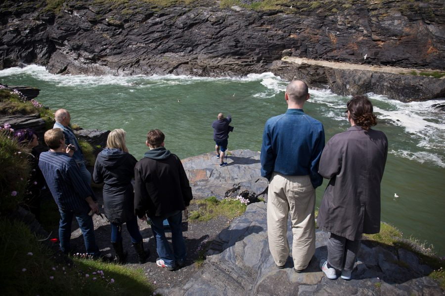 People standing on a cliff edge
