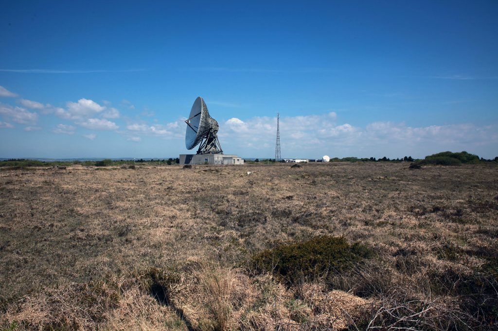 Earth station satellite dish in the landscape