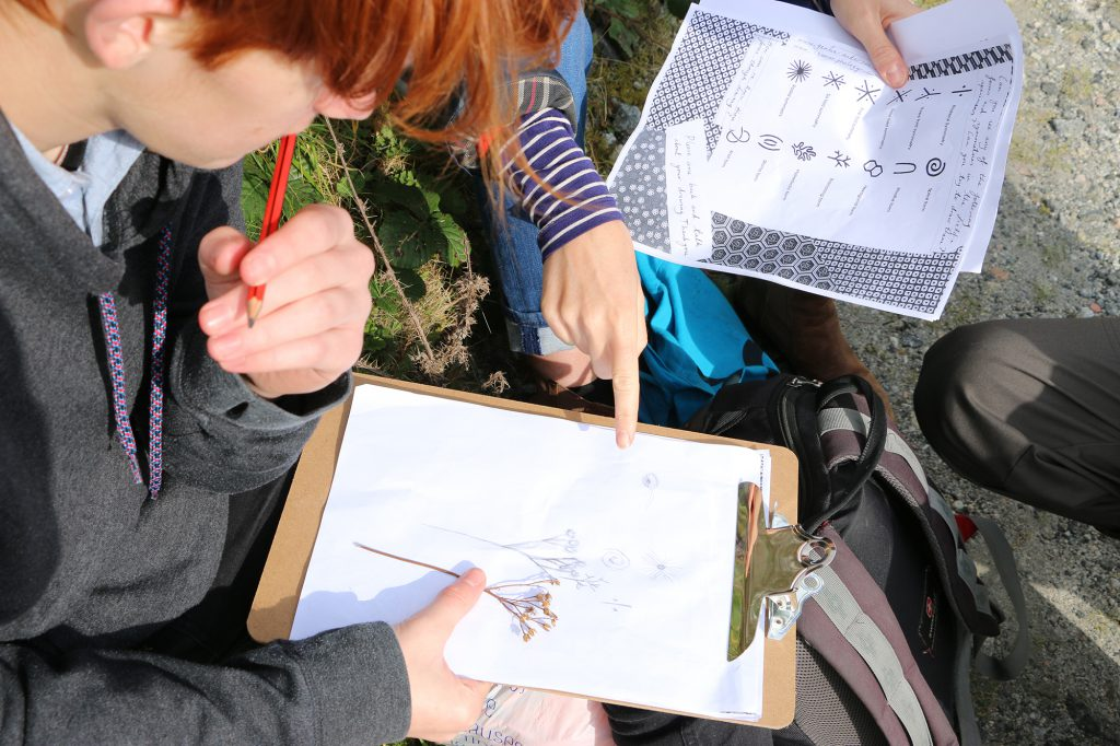 Students discussing a drawing
