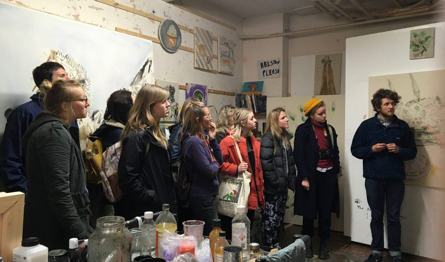 Students viewing an artist's studio