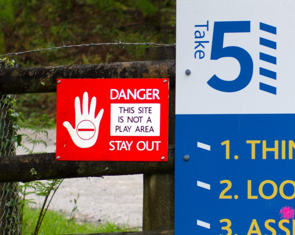 A sign with an image of hand signalling 'danger'
