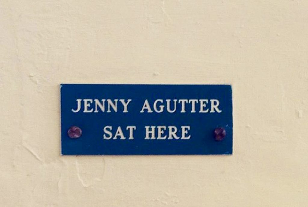 A sign on a wall, reading 'Jenny Agutter Sat Here'